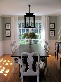 This popular dining room is a little less cluttered. The hanging lantern above the table is a great idea that enhances the cottage-feel of the home. Small Dining Room Furniture, Tiny Dining Rooms, Elegant Dining Room, Beautiful Dining Rooms, Luxury Dining Room, Dining Room Lighting, Dining Room Design, Chandelier Lighting, Dining Table