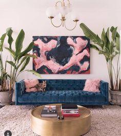 Blue velvet tufted sofa.