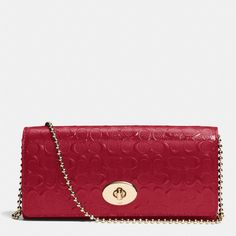 The Slim Envelope On Chain In Signature Embossed Patent Leather from Coach. Pretty purse i want it.