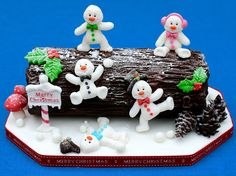 Rocky Road Yule Log Project by Sarah Harris - - Make this whimsical Rocky Road Yule Log for a festive treat this Christmas! Created by design team member Sarah Harris from The Cupcake Range. We hope you love it just as much as we do! Christmas Log Cake, Christmas Cake Designs, Christmas Cake Topper, Christmas Goodies, Christmas Desserts, Christmas Treats, Christmas Snowman, Father Christmas, Christmas Wedding