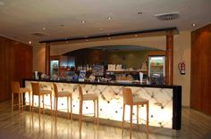 Love the lighting on the front of the counter. It really brings attention to the counter and makes the whole space look romantic and like a lounge.   Refresh yourself at the Sala Montana Roja Lounge at Tenerife South - Reina Sofia
