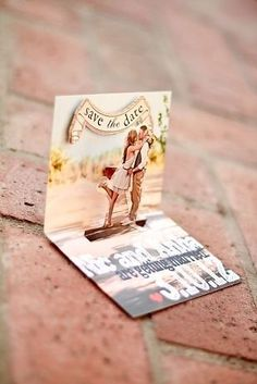 We love this popup wedding invitation with the personalised image and save the date banner