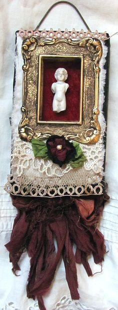 mini frozen charlotte textile assemblage