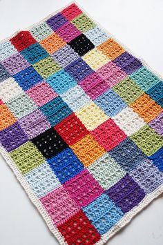 Muskat Blanket, free pattern by Madeleine of Yarn-Madness; great way to use up scraps by making a colorful patchwork blanket.  #crochet #afghan #throw