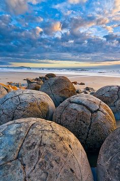 Moeraki Boulders, known as the Dinosaur Eggs, New Zealand. The Moeraki Boulders are unusually large and spherical boulders lying along a stretch of Koekohe Beach on the wave-cut Otago coast of New Zealand. Places Around The World, The Places Youll Go, Places To See, Around The Worlds, Beautiful World, Beautiful Places, Beautiful Beach, Amazing Places, Moeraki Boulders