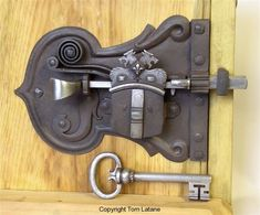 Hand Forged front door lock with crest design.