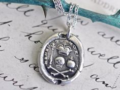 skull and crossbones wax seal necklace, under a crown with scepter and orb ... memento mori - sterling silver antique wax seal jewelry by suegrayjewelry on Etsy https://www.etsy.com/listing/231109173/skull-and-crossbones-wax-seal-necklace