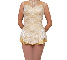 This dress comes with around 4+ gross of Pellosa stones in crystal AB and light sapphire. The bodice features lace over gold mystique fabric. Its a metallic shimmer fabric that Olympic gymnasts like to wear to highlight their figures. Its beautiful and with a lace overlay.  The dress has the perfect amount of sparkle. Crystals are scattered along the dress and also form a necklace on the neckline. Most people cant tell the difference at a distance between Swarovski and Pellosa stones when…
