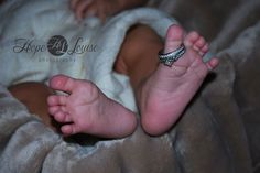 Baby toes with mom's wedding ring :)