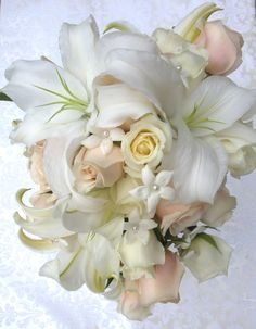 the stephanotis wouldn't make it two hours at a wedding but this bouquet is sooooo beautiful (&expensive)