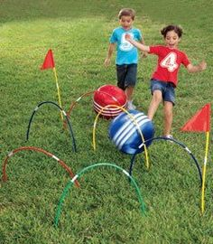 """""""Kick croquet""""- make your own with hula hoops. Cut them at an angle with a utility knife to make sharp ends you can firmly dig into the grass.    (borrowed from Proverbs 31 Ministries)"""