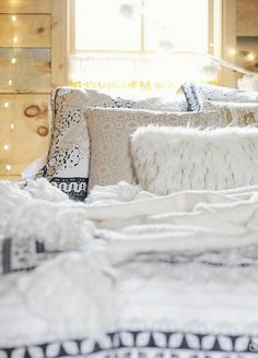 I love the mix of textures it feels so cozy. Not a fan of the Christmas lights, I'm not living in the dorms anymore....
