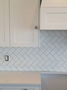 flourish design + style: new house files   kitchen backsplash - subway tile in herringbone pattern. I would do white grout