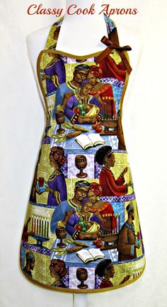 This beautiful print features 17 amazing colors and depicts a family celebrating Kwanzaa, showcasing the candles & holder, crops, mat, corn, gifts, and unity cup. So that it may become a family heirloom, we lined it in a coordinating color, trimmed it in Mocha and added a bronze satin bow at left bib corner. You can serve up a feast, or maybe just dinner for two, while celebrating the spirit of Kwanzaa every day of the year! Kwanzaa begins on Wednesday, December 26 and ends on Tuesday, Jan…
