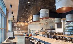 Honor Society restaurant interior design: textures galore and those gold inside barrels!