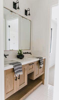 Home Decor Bathroom Minimal farmhouse bathroom with black metal faucets.Home Decor Bathroom Minimal farmhouse bathroom with black metal faucets Diy Bathroom, Bathroom Floor Tiles, Chic Bathrooms, Bathroom Renos, Bathroom Styling, Bathroom Interior, Modern Bathroom, Small Bathroom, Bathroom Ideas