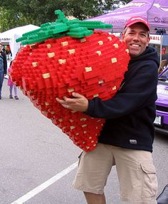 """""""50-pound LEGO strawberry"""" built by Robin Sather (shown), Canada's only LEGO Certified Professional. Click through for photos of more of Robin's creations"""