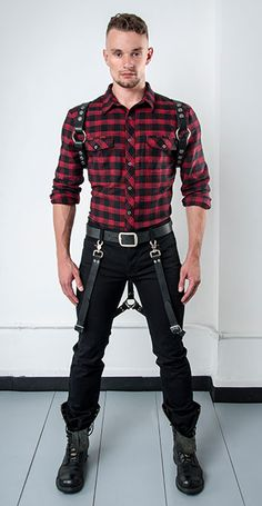 Red check shirt and black trousers with leather straps