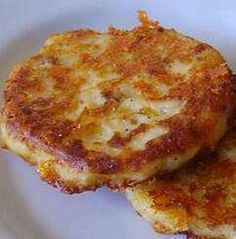 Bacon Cheddar Potato Cakes- 3 slices bacon 4 cups cold leftover mashed potatoes 2 eggs 1 teaspoon onion powder 1/2 teaspoon salt 1/2 teaspoon ground black pepper 1 cup shredded Cheddar cheese,cook bacon over medium-high heat, about 10 minutes. Remove the bacon slices, crumble, and set aside. Leave the bacon drippings in the skillet.  Mix the mashed potatoes, eggs, onion powder, salt, and black pepper together in a bowl; stir in the crumbled bacon and Cheddar cheese.