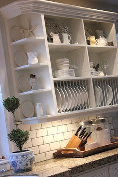 counter, tile, cabinet, little shelves... nice
