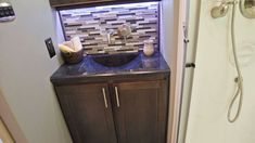 Brazilian decor in the bathroom of this Luxe 45FB Toy Hauler Luxury Fifth Wheel, Fifth Wheel Toy Haulers, Toys, Bathroom, Decor, Activity Toys, Washroom, Decoration, Clearance Toys