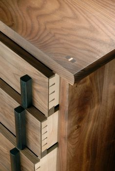 Open draws on walnut bedside cabinet by Nick Thwaites Furniture.