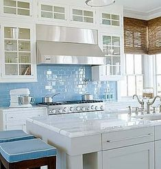 Coastal beachy kitchen with aqua glass tile