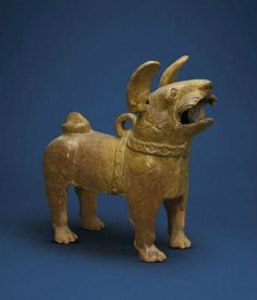 A straw-glazed pottery figure of a dog, Han dynasty (206 BC-AD 220)