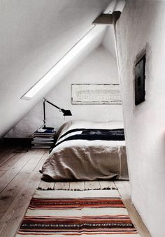 Tiny loft bedroom, steep pitch. wouldn't mind this then the rest of the house a studio