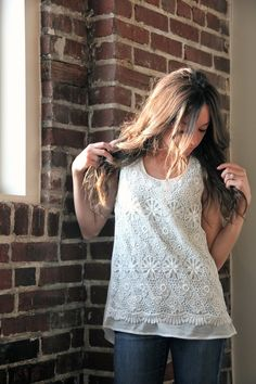 Cute lace detailed tank. Nice all seasons piece - good for layering under a cardigan or by itself in the summer.