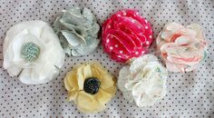 These no sew fabric flowers could be used for decorations, head bands or hair clips, tie a bow with one of these on it around a mason jar - they ideas are endless!  FROM:~Ruffles And Stuff~: No-Sew Fabric Flower Tutorial