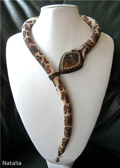 Large bead framed gemstone as the snake's head. Beaded snake's tongue is the loop closure.