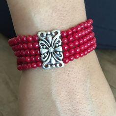 Sterling silver red Coral bracelet. Sterling silver red Coral bracelet, it's stretchable. It fix most. Price ✂ Jewelry Bracelets