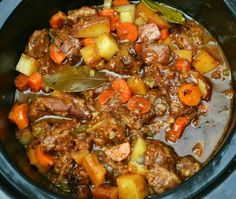 2 pounds beef stew meat 1/2 cup all purpose flour 1 tablespoon seasoning salt 2 tablespoons olive oil 1/2 teaspoon black pepper 1 large onion, diced 2 bay leaves 1/4 cup Worcestershire sauce 2 cups water 2 heaping teaspoons beef demi-glace (or beef Swanson Flavor Boost) 4 medium to large red skinned potatoes, washed & diced 3 large carrots, peeled & sliced 1 stalk celery, diced