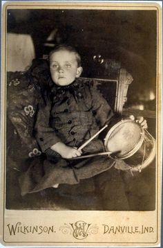 The back of this circa 1890 cabinet card states that the family took their recently deceased son and his favorite toys to the the photographer Wilkinson in Danville, Indiana. Postmortem photographs were common in the Victorian era when childhood mortality rates were much higher. Photographic mementos were cherished by family members. (Courtesy of the Hendricks County Historical Society)
