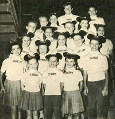 the Mouseketeers from the television program The Mickey Mouse Club in May of 1957. From left: Annette Funicello, Karen Pendleton, Cubby O'Brien. Row two: Charley Laney, Sharon Baird, Darlene Gillespie, Jay Jay Solari. Row three: Tommy Cole, Cheryl Holdridge, Larry Larsen, Doreen Tracey, Eileen Diamond. Back row: Lonnie Burr, Margene Storey, Jimmie Dodd, Bobby Burgess.