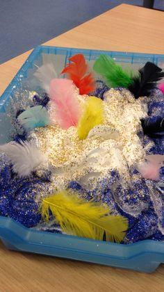 The gruffalo 'owl ice cream' sensory tray... Shaving foam, feathers and glitter (lots and lots of glitter!)