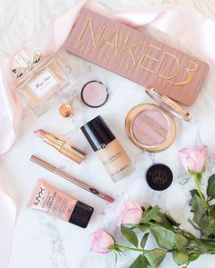 Urban Decay Naked 3 Palette, Armani Luminous Silk Foundation, Charlotte Tilbury, Miss Dior makeup flatlay