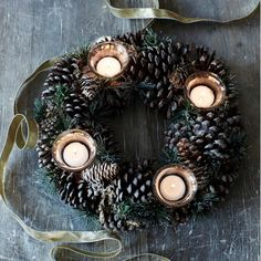Fir Cone Tealight Ring - might try this for Christmas lunch table