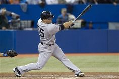 GAME 157: Friday, Sept. 28, 2012 - New York Yankees' Russell Martin swings on a three-run home run off Toronto Blue Jays pitcher Jason Frasor during the sixth inning of a baseball game in Toronto.
