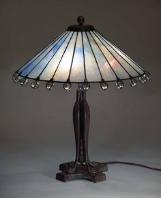 "18"" Straight Panels Cone Tiffany lamp on Lions Claw telescoping bronze lamp base"