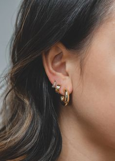 We love how minimal and versatile these hoops look together! Now you can get our bestselling pieces in one stack. Featuring our Baby Celine Hoops, Small Huggie Hoops and Cluster Stone Hoops in gold. Beaded Choker Necklace, Gold Hoop Earrings, Gold Hoops, Light Gold Color, Gold Colour, Multiple Earrings, Lobe Piercing, Multiple Ear Piercings, Sterling Silver Hoops
