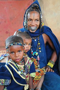 Fulani Tribe, Mali. Beautiful shot. I like the range of emotion from the subjects, especially the little one peeking out apprehensively.