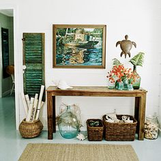 Make a welcome statement by grouping all of your beachy finds together at your entry: small seashells in a clear glass jar, conch shells in a large woven basket, and fishing floats in a smaller basket.