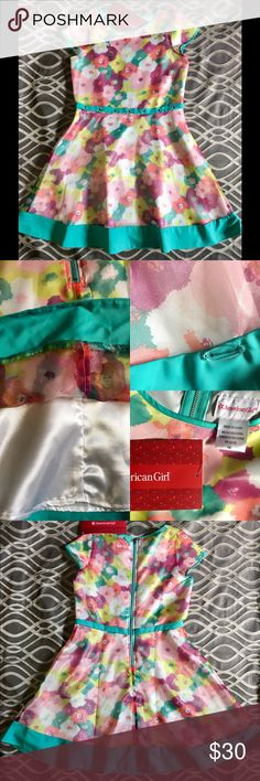"NWT American Girl Sz16 Bright Blooms Dress NEW - WITH TAGS American Girl  Bright Blooms Dress Size: Girls 16 Bust: 16"" Wide Waist: 15"" Wide  Skirt Length: 19"" Long Under Arm-Waist: 7""  Shoulder-Waist: 15""  (Measurements are described & done to the best & most accurate, as possible!!) PLEASE BE FULLY AWARE OF ITEM, PRIOR TO FINAL PURCHASE!  Questions always welcome! Thx for all the support, in sharing, liking/loving, & the purchase of my items! I enjoy passing it on, as well!  This has…"
