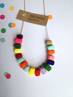 This is the CONFETTI necklace. It is a handmade Boxy STRING necklace. It is made of seventeen handcrafted beads and threaded onto 90cm of braided