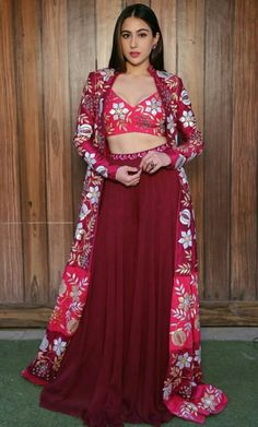 Exclusive Bollywood Inspired Sara Ali Khan in Maroon Coloured Beautiful Printed Top With Matching Palazzo. The Palazzo is Fully Stitched .It Comes with matching koti which is semi-stitched and can be Customised According to your Style and Fit. Dress Indian Style, Indian Fashion Dresses, Indian Designer Outfits, Designer Dresses, Pakistani Dresses, Tribal Fusion, Indian Wedding Outfits, Indian Outfits, Jacket Lehenga