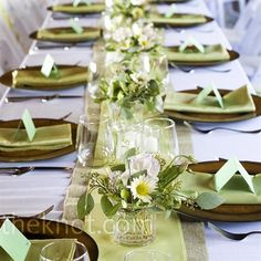 LOVE THIS TABLE. In keeping with their eco-friendly theme, Kate and Zach repurposed wine and beer bottles for their centerpieces, and then filled them with locally grown wildflowers.