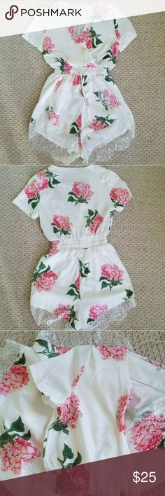 XS/S Floral pink and white romper with lace detail Gently used twice! Great condition,  no stains , no odors , beautiful lace details , size Xs but run big so i listed XS S boutique Pants Jumpsuits & Rompers