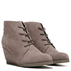 Look fashion forward in the Madden Girl Domain wedge boots.Fabric upper in a wedge boot style with a round toeLace-up frontTextile lining with a cushioning footbedTraction outsole3 inch wedge heel